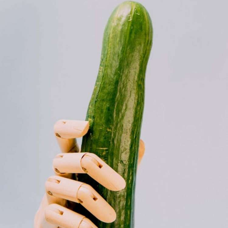 cucumber and hand